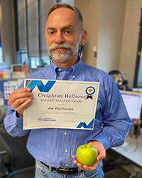 Joe Ducharme holding the Wellness Award