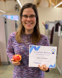 Kelly VanEngen holding the Wellness Award